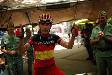 Spanish mountain biker Jose Marquez, 40, poses for the media after winning the cycling category in the XIX 101km international competition in Ronda