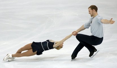 Kayne and O'Shea of the U.S. perform during the pairs free skating program at the Rostelecom Cup ISU Grand Prix of Figure Skating in Moscow