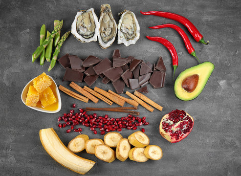 Different aphrodisiac food for increasing sexual desire on gray table
