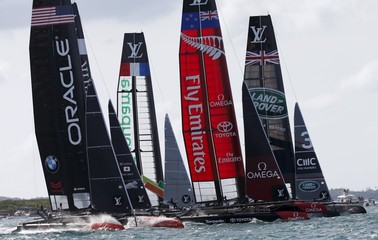 AC45F racing sailboats cross the starting line during race 3 of the America's Cup World Series sailing competition on the Great Sound in Hamilton