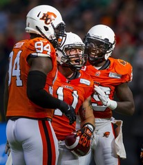 B.C. Lions LB Hoffman-Ellis celebrates his fumble recovery after a Saskatchewan Roughriders turnover with teammates during the first half of their CFL football game in Vancouver.