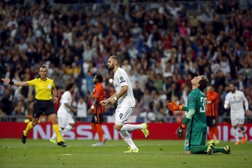 Real Madrid's Benzema celebrates scoring against Shakhtar Donetsk during their Champions League Group A soccer match at Santiago Bernabeu stadium in Madrid