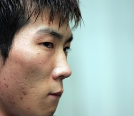 South Korean gymnast Yang reacts during a news conference at Olympic Hall in Seoul.