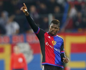FC Basel's Embolo celebrates his goal with team mates during their Europa League soccer match against Lech Poznan in Basel