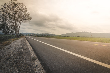road in windy and cloudy day in thailand