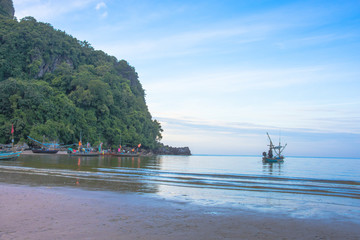fishing boat near moutain natural seascape sky blue