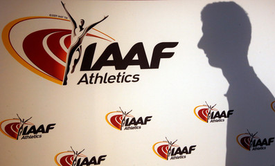 Man casts his shadow following press conference by IAAF's President Coe as part of 203nd IAAF council meeting in Monaco