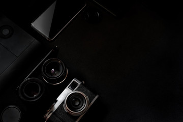 Designer desk mockup. Desk, Camera - Photographic Equipment, Smart Phone on dark top table.