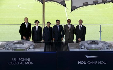 FC Barcelona member of the board Moix, architect Katsuka, Nikken Sekkei's President Kamei, president Maria Bartomeu, architects Pascual and Ausio pose with a model of the project to renovate Camp Nou stadium in Barcelona