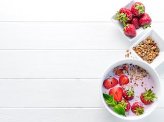 Nutritious breakfast with granola, copyspace left, topview