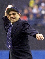 File photo of New York Yankees Hall-of-Famer Yogi Berra throwing out the opening day pitch before the Yankees game with the Detroit Tigers at the Yankee Stadium