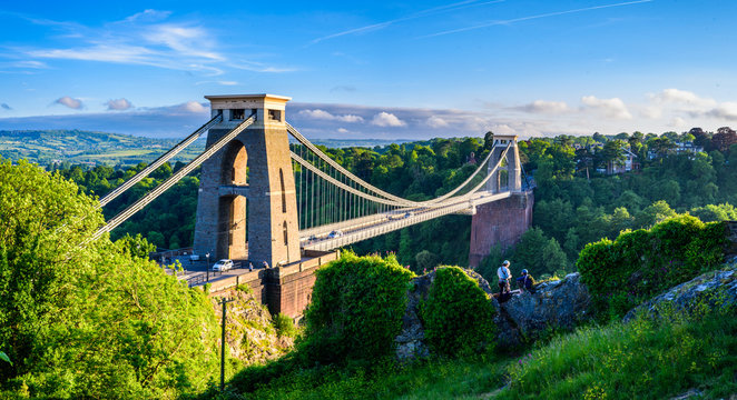 Bristol suspension bridge at sunset with climbers