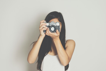 Woman take picture with a vintage old camera