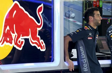 Red Bull Formula One driver Ricciardo stands in the pit ahead of the Russian Grand Prix in Sochi
