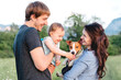 Close-up portrait of happy family with pet - jack russel terrier, walking outside. Baby and dog.