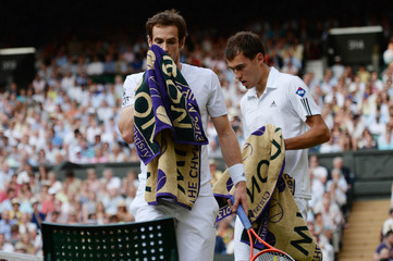 Men's Singles - Great Britain's Andy Murray (L) and Poland's Jerzy Janowicz during their semi final match