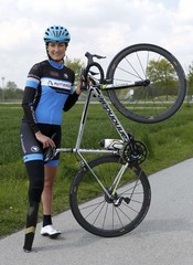 German paralympic cycling athlete Denise Schindler poses with her bicycle in Olching