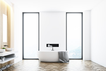 White bathroom near a window