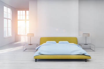Yellow bed, white floor toned