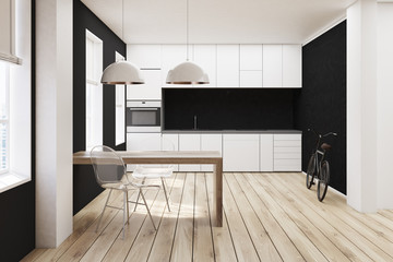 White and black kitchen, wooden floor