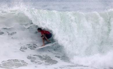 John John Florence of Hawaii surfs during the World Surf League Rio Pro championship men's semi-final at Barra da Tijuca beach in Rio de Janeiro