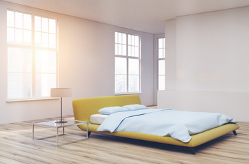 Yellow bed, wooden floor corner toned