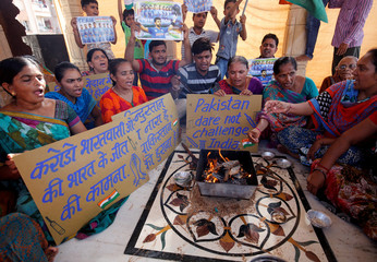 Fans offer special prayers for the victory of the Indian cricket team on the eve of the ICC Champions Trophy finals between India and Pakistan at The Oval, inside a temple in Ahmedabad