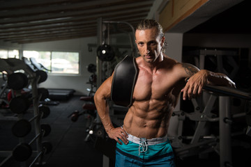 Attractive Man Resting In Gym Afther Exercise
