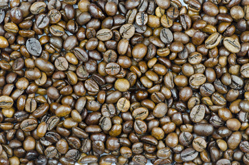 A close-up view of coffee bean texture with space for text