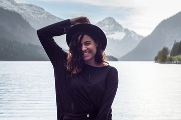 Photoshooting beautiful black swedish woman by mountain lake Tyrol