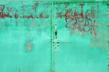 Old green metal door texture for background