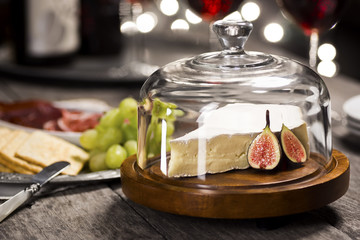 Brie Cheese Wedge with Figs and Red Wine at Holiday Party