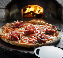 Pizza with glass of red wine