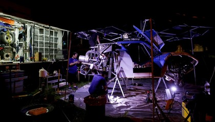 Mechanics work on the Buggy Isuzu of Laureano Campanera of Argentina at the bivouac of the Dakar Rally 2016 in Salta