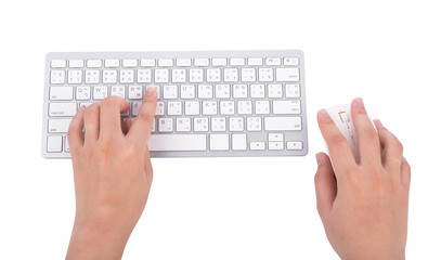 Woman hand typing on keyboard with mouse on white