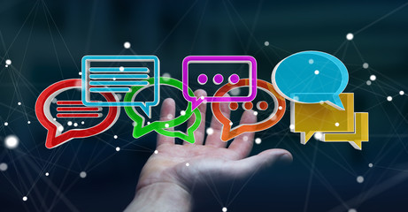 Businesswoman using digital colorful 3D rendering conversation icons