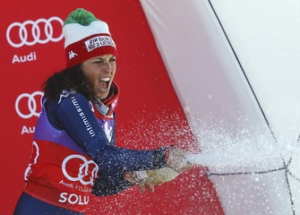 Brignone of Italy sprays sparkling wine on the podium after winning the alpine World Cup Ladies' Giant Slalom race on the Rettenbach glacier in the Tyrolean ski resort of Soelden