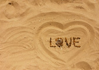 Love letters and sings on a sand