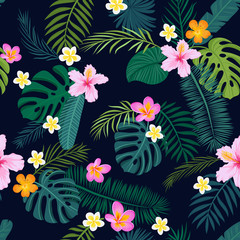 Tropical seamless pattern with palm leaves and flowers