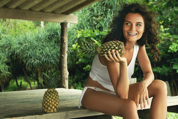 Woman with curly hair and pineapple