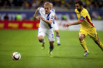 Finland's Pohjanpalo challenges Romania's Rat during their Euro 2016 Group F qualification soccer match in Bucharest