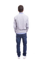 Young guy standing from back on white background