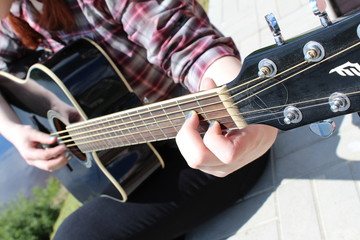 Guitar neck and guitarist's hands