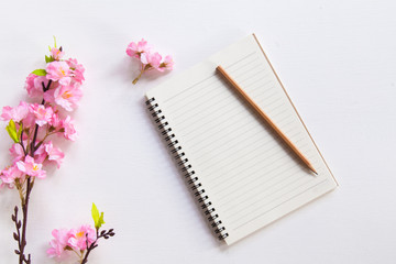 Sakura,note book on wooden table,Top view