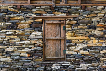 Stone wall and wooden door