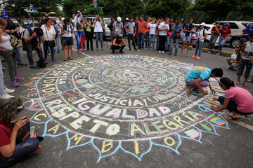 Children make a street chalk drawing during a rally against Venezuela's President Maduro in Caracas