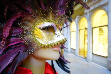 Colorful Venetian carnival mask on the street in Venice