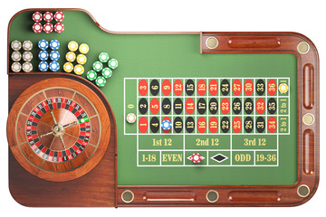 Casino roulette wheel with casino chips on green table isolated on white background. Gambling.