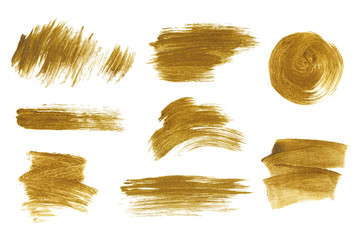 Gold metallic brush stroke set. Isolated hand drawn vector brushes. Gold glitter texture.