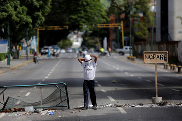 An opposition supporter is seen during a rally against Venezuela's President Maduro in Caracas